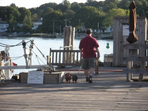 Geoff and the dogs on the pier by the Amistad.