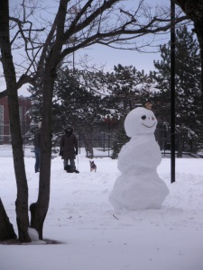 A snowperson presides over the park.