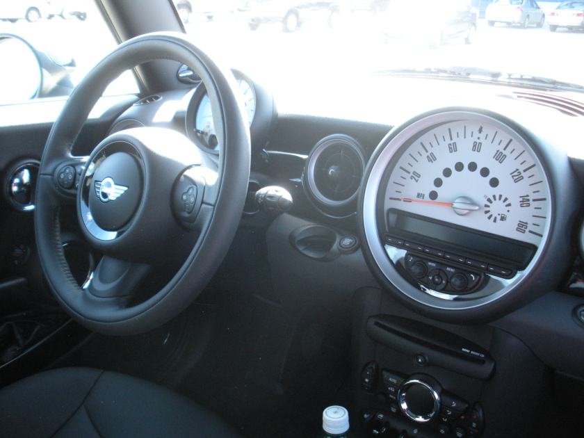 The dashboard and steering wheel.