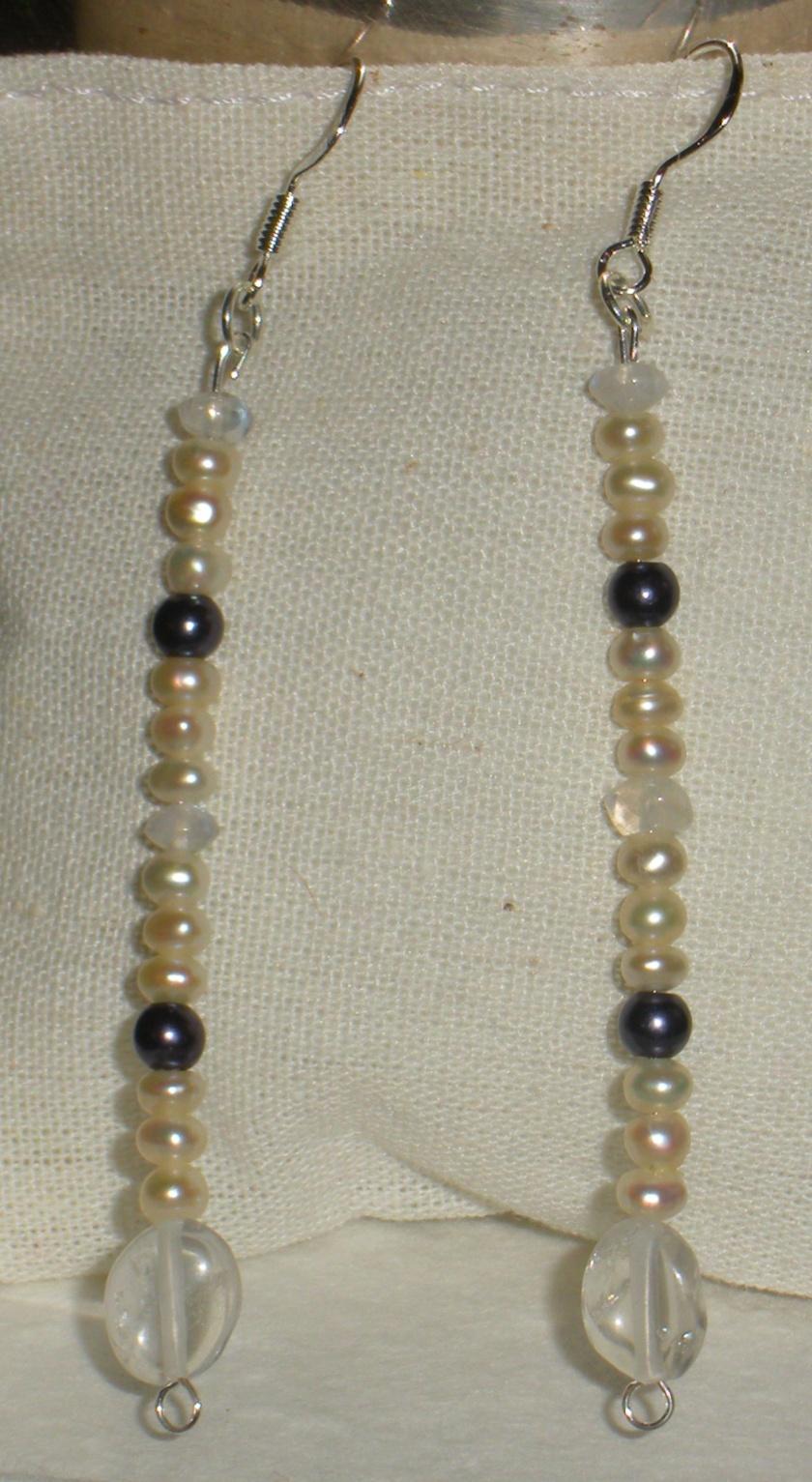 Moonstone, freshwater pearl, peacock pearl, rock crystal.