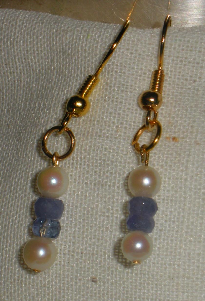 Cultured pearl and tanzanite.