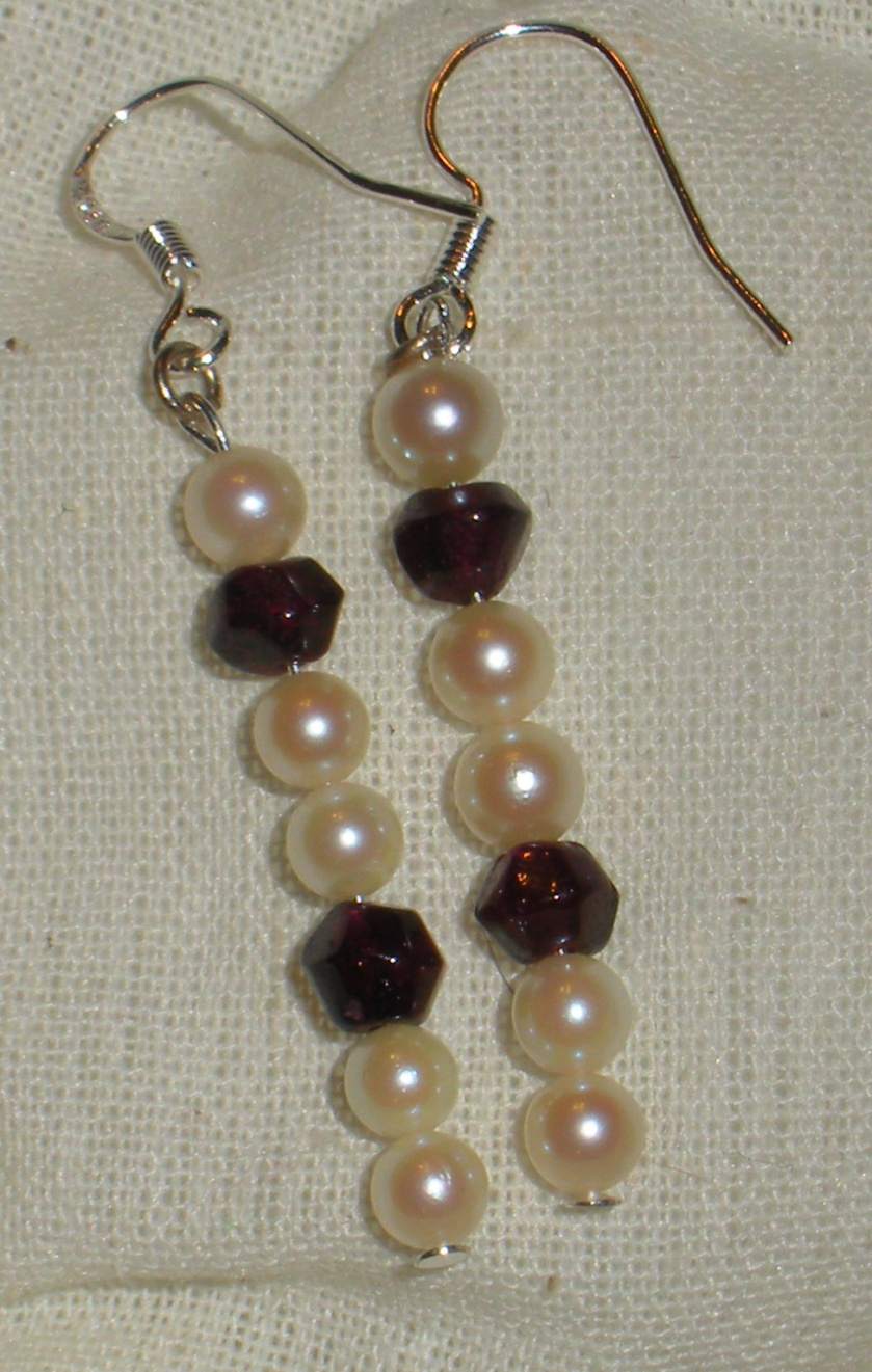 Cultured pearl and garnet.