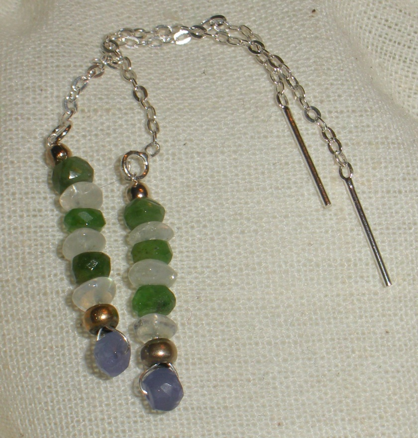 Tsavorite garnet, moonstone, vintage sterling beads, tanzanite.