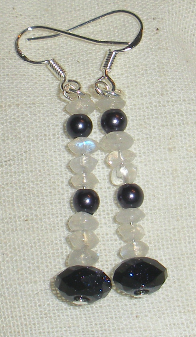 Moonstone, peacock pearl, blue goldstone.
