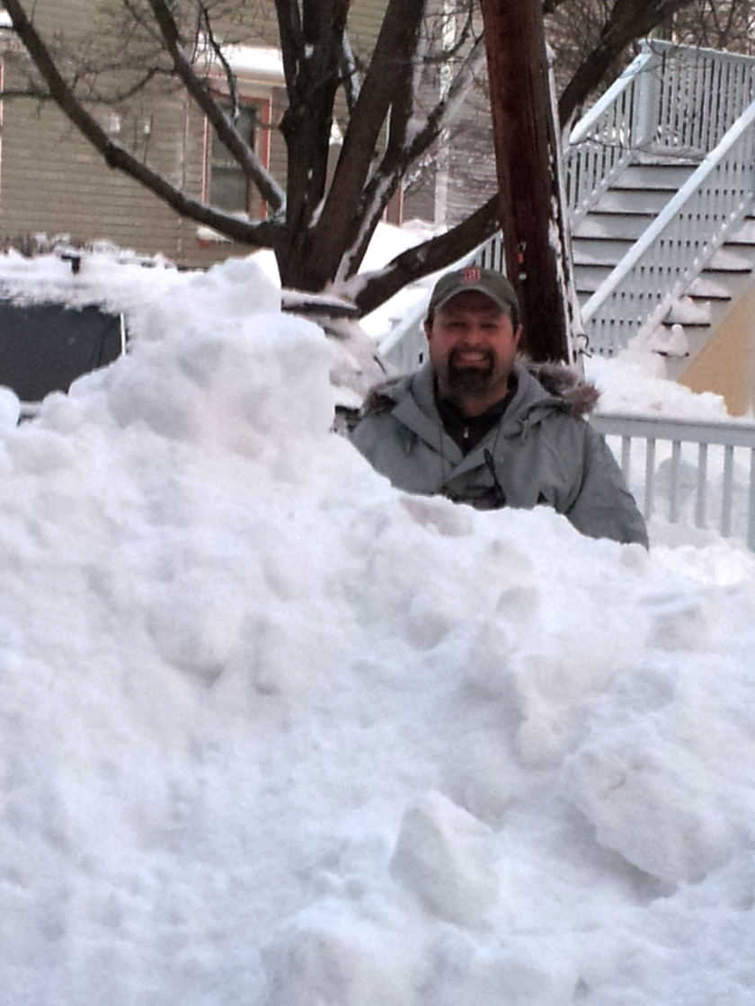 Geoff is standing next to this pile of snow for scale.  No, it isn't a buried car, it is a pile from a plow.  It is as tall as he is, easily 8-9 feet long, and 7-8 feet deep from the curb.  And there's no car in there, just snow.