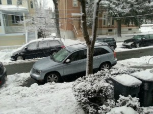 This is a lesson in How Not to Park in Snow.  The plows were having trouble getting by.  The Police showed up.  Don't be This Guy.