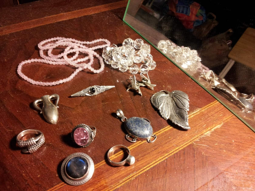 Beads, pins, pendants, brooches, and rings.  Some really great old stuff here.