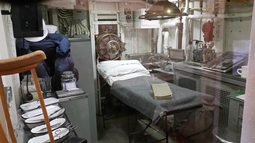 Sick bay, showing the generally small size of the room.  In combat the wardroom would sometimes become an operating room.