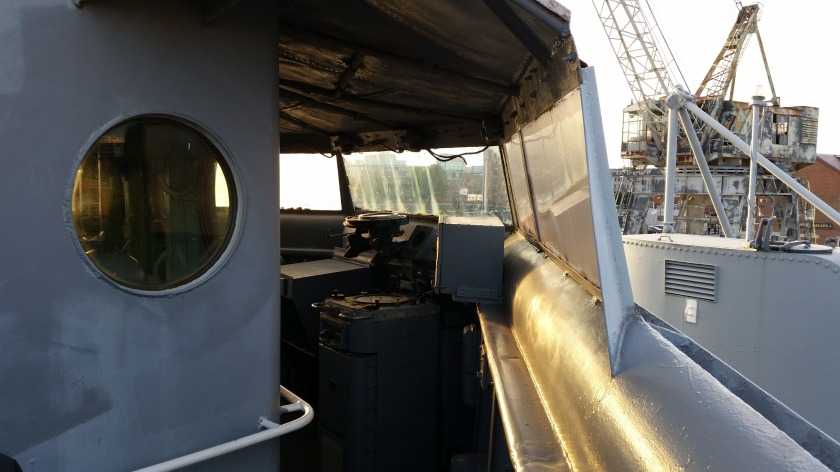 View of the bridge from the starboard side bridge wing.  The wind screens and roof were added post-World War Two.