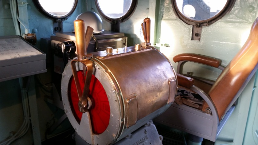 The main engine telegraph.  I believe that chair was for the captain while he was on the bridge.