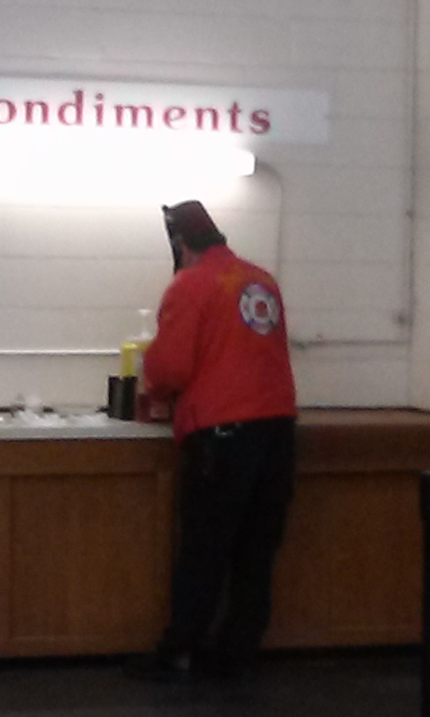 Fez man is getting condiments for his food.